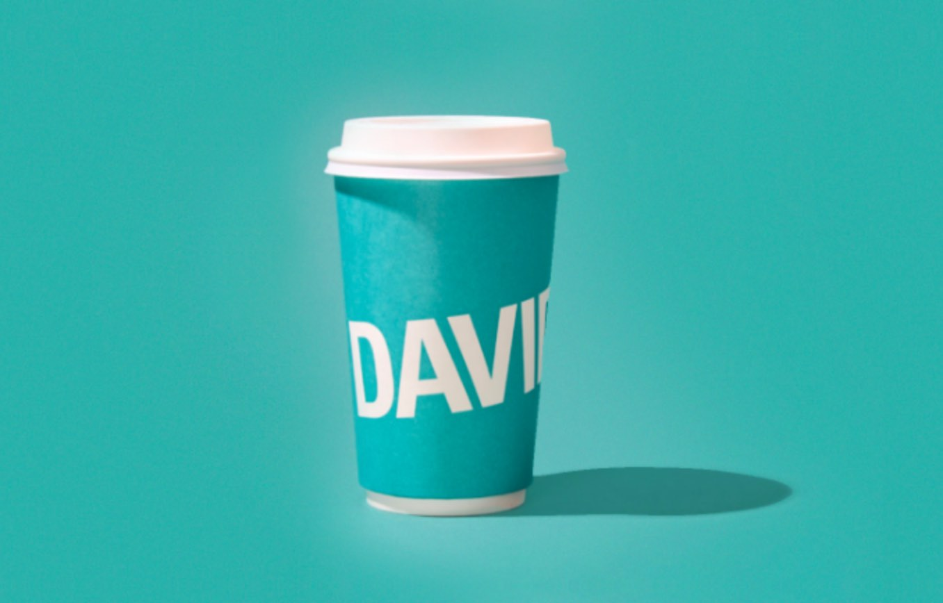 16 oz teal DAVIDsTEA to-go cup with white lid.