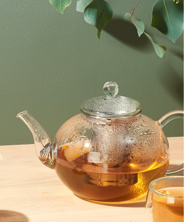 28 oz clear glass teapot filled with hot green tea