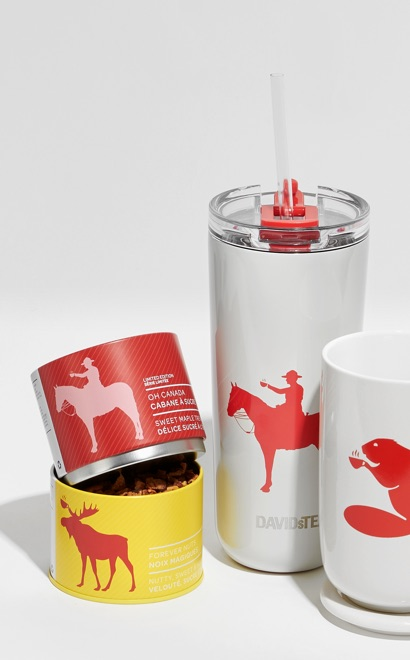 Multiple white mugs and travel mugs with a red logo on a white background.