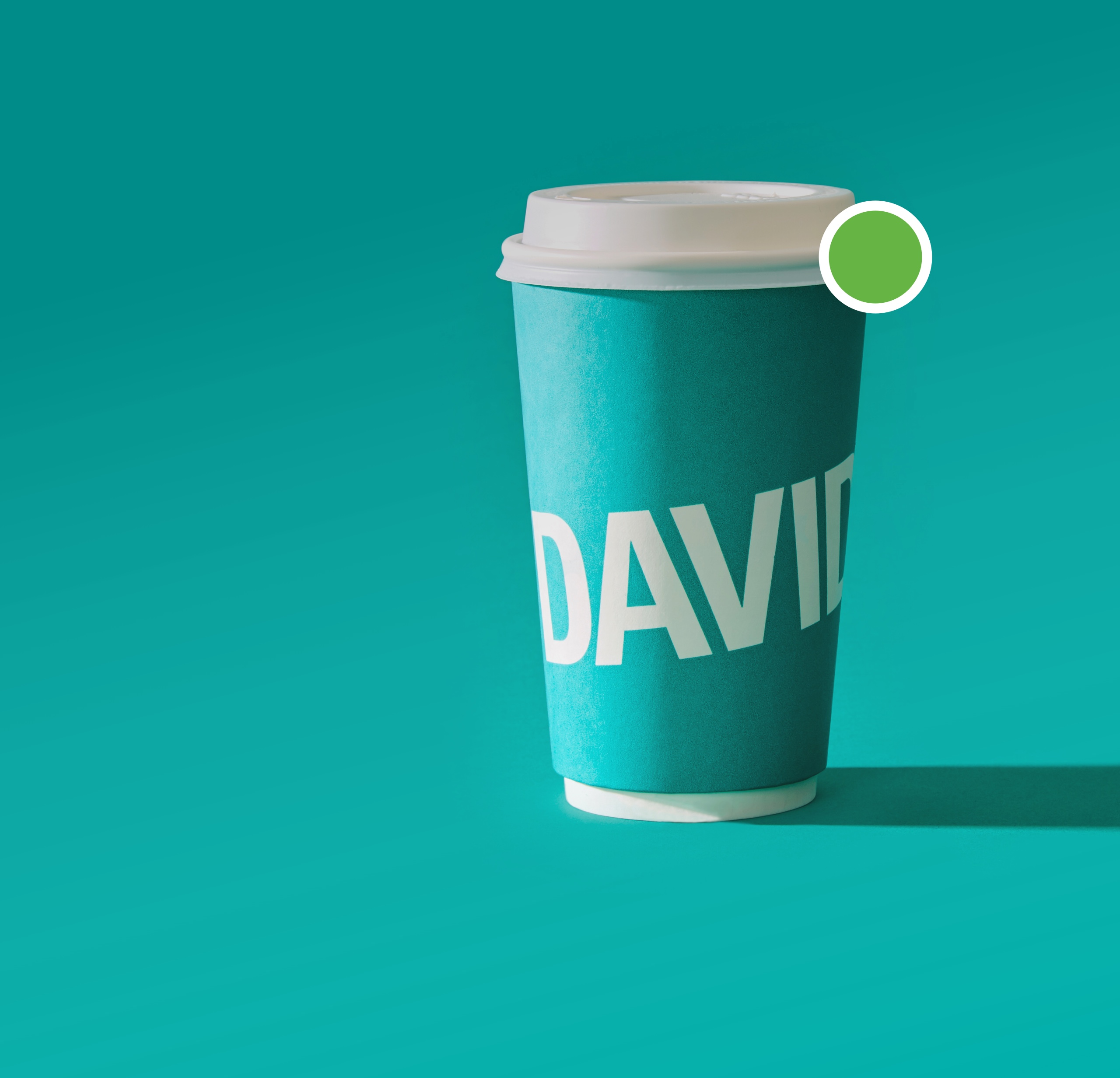 DAVIDsTEA teal to go cup with green active chat bubble.