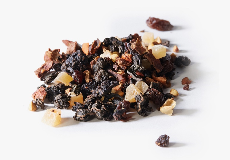 Maple Syrup Oolong tea ingredients placed on a white surface.