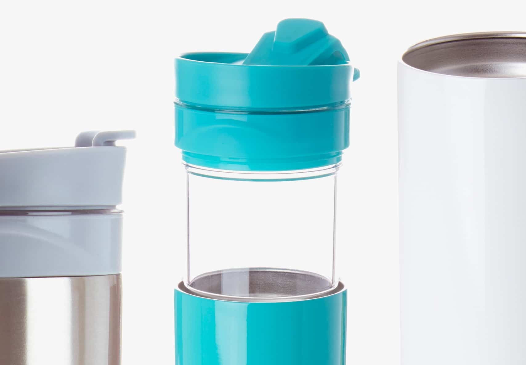 Three colourful travel mugs placed next to each other.