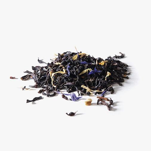 Raw ingredients of Organic Cream of Earl Grey spread on a white ground: Organic black tea, cornflowers and Organic marigolds.