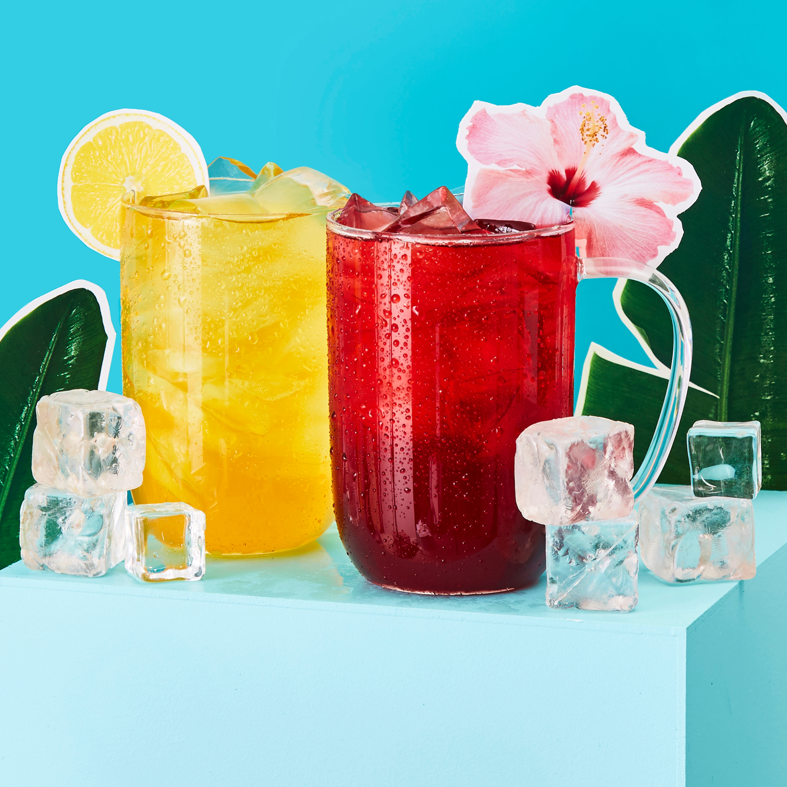 Clear 16 oz glass mug with lemonade iced tea, clear 16 oz glass mug with hibiscus iced tea.
