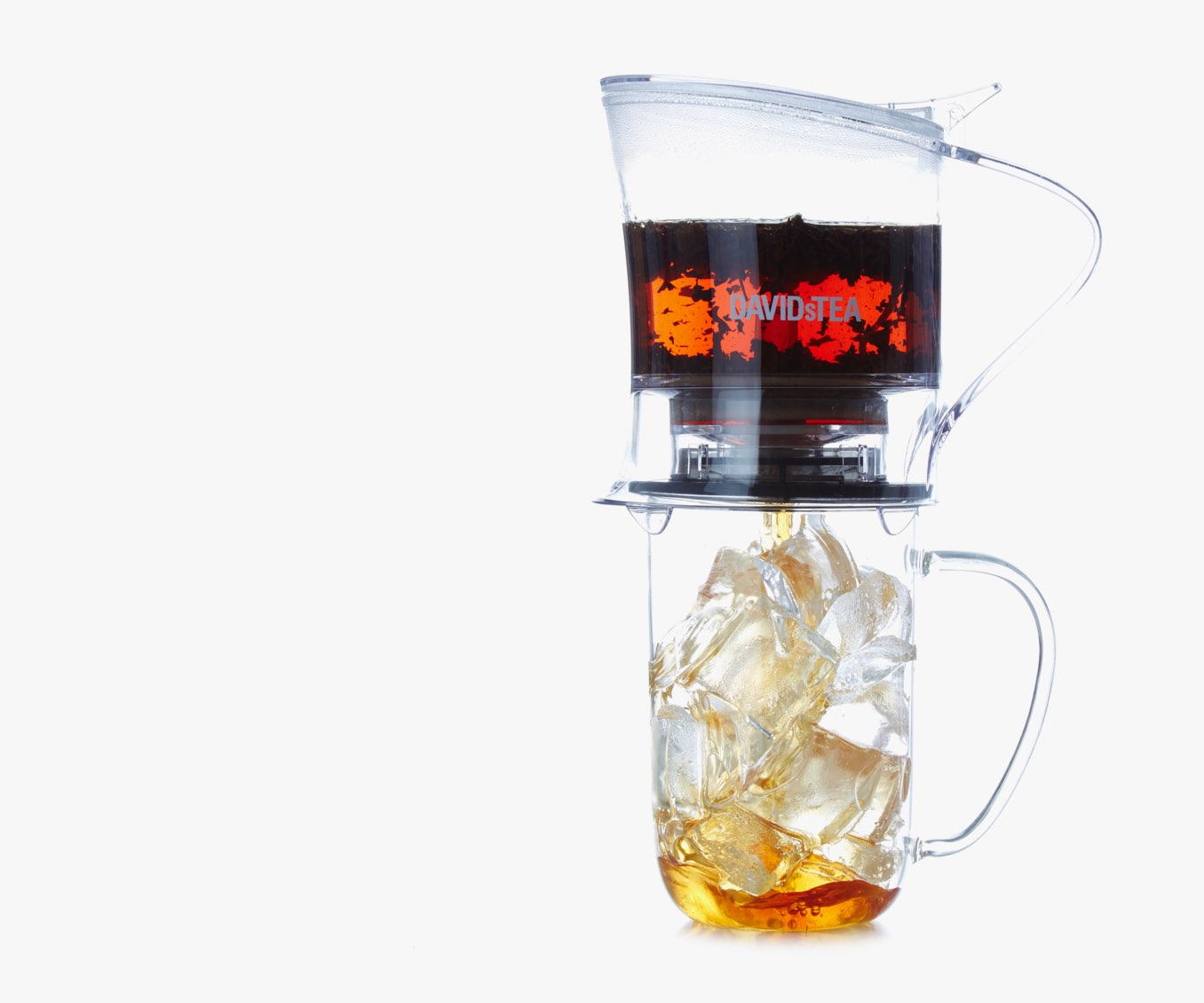 Clear 16 oz tea maker dispensing tea into clear 16 oz glass mug filled with ice.