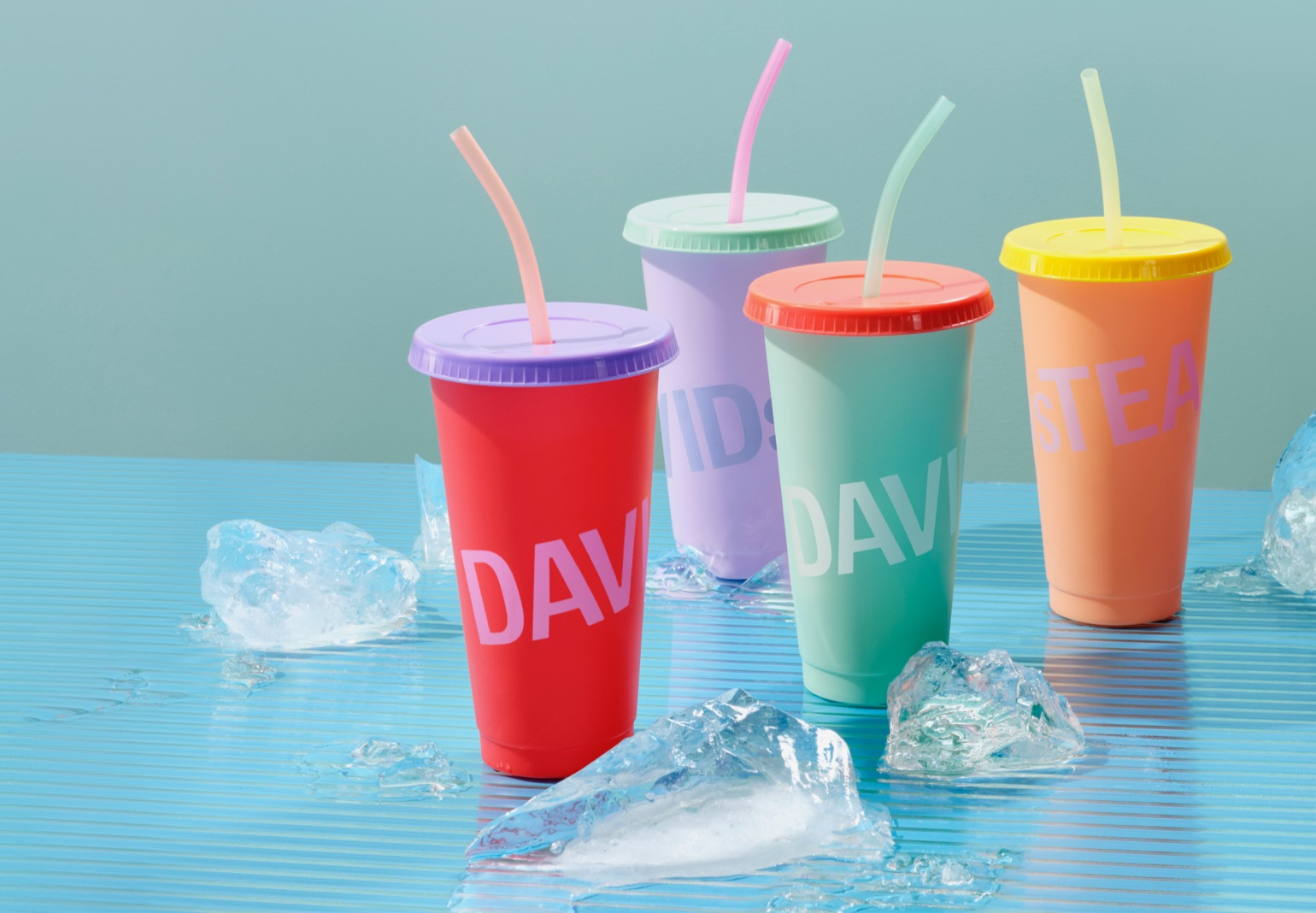Four colour-changing cups with ice next to them.
