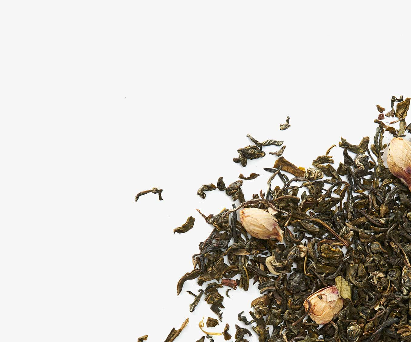 Loose leaf white tea placed in the bottom right corner on a white background.