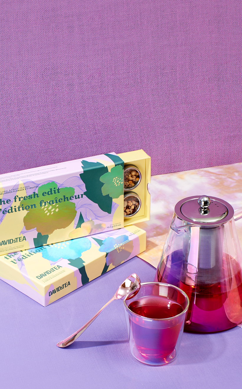 A tea set filled with tea next to The Fresh Edit 8 tea sampler.