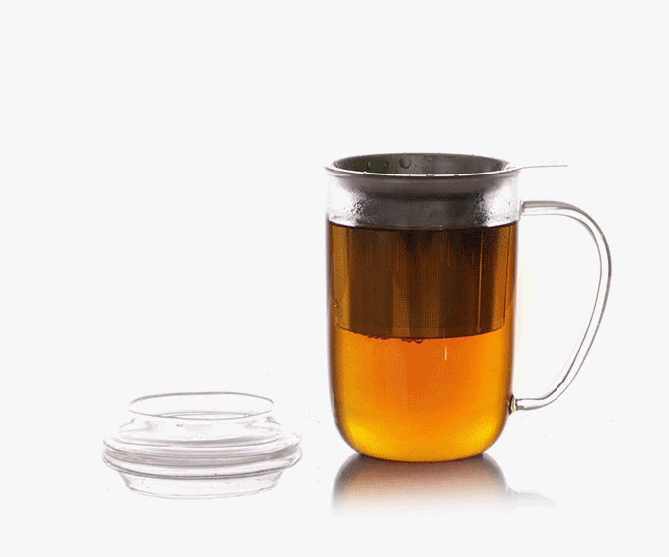 Chai tea infusing in clear 16 oz glass mug with stainless steel tea infuser.