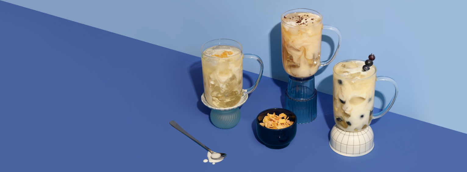 Three 16 oz DAVIDsTEA to-go cups with Frosted Cereal, Blueberry Shake and Vanilla Cappuccino iced lattes.
