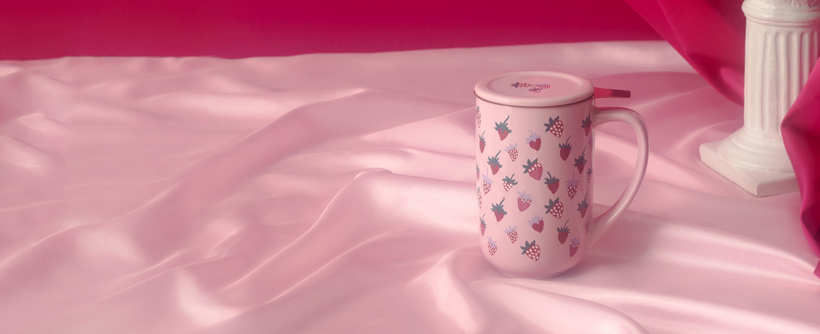A Nordic mug with a strawberry print.