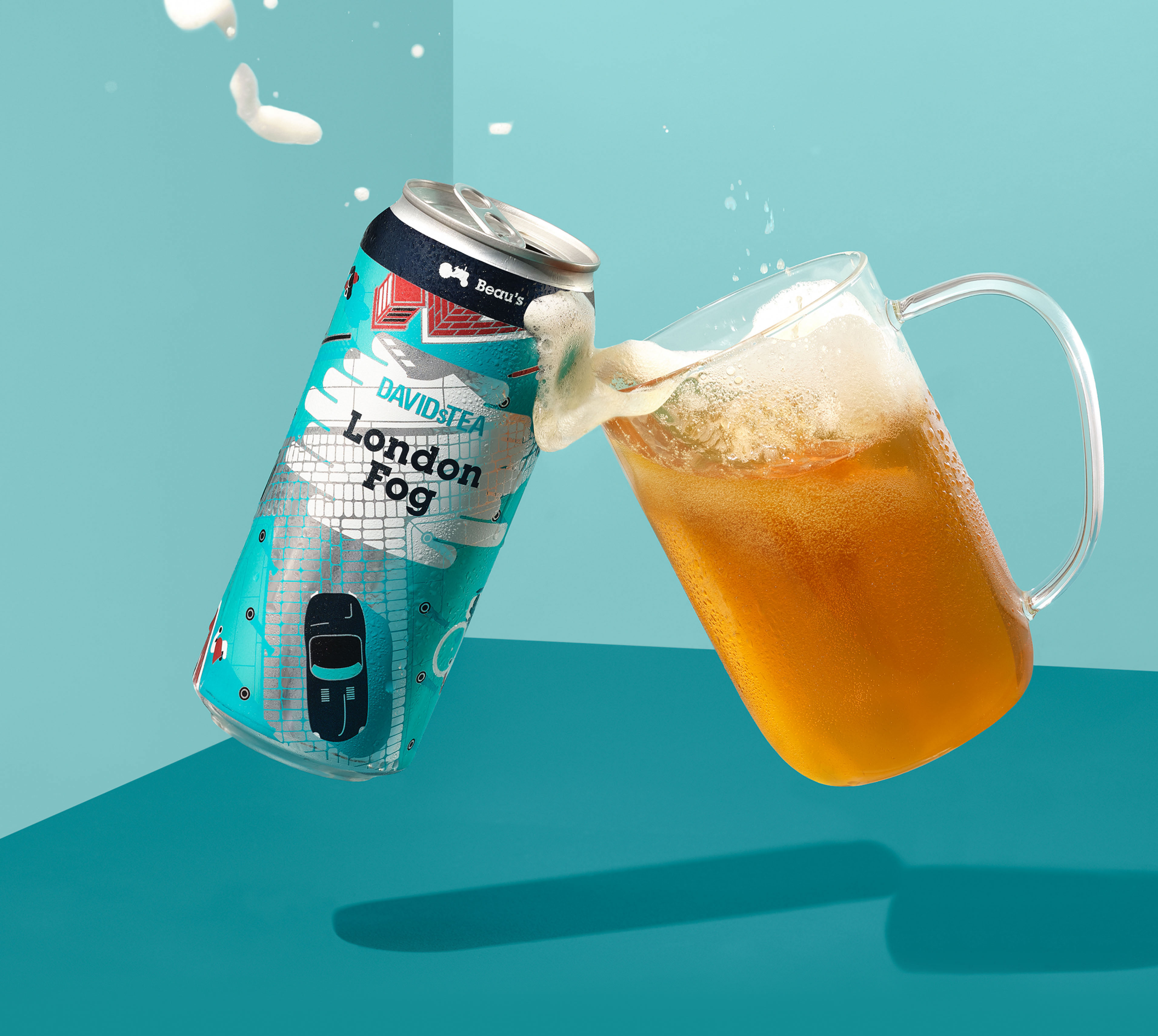 London Fog can clinking with clear mug filled with London Fog beer.