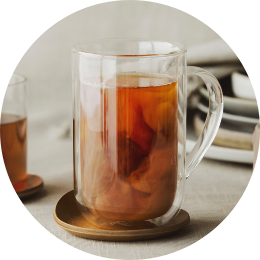 Clear 18 oz double-walled glass latte mug filled with iced tea.