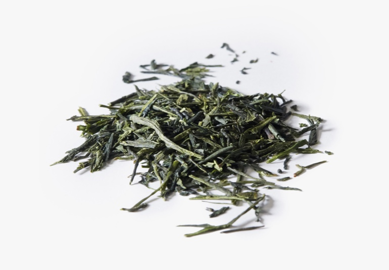 Japanese Sencha tea ingredients placed on a white surface.