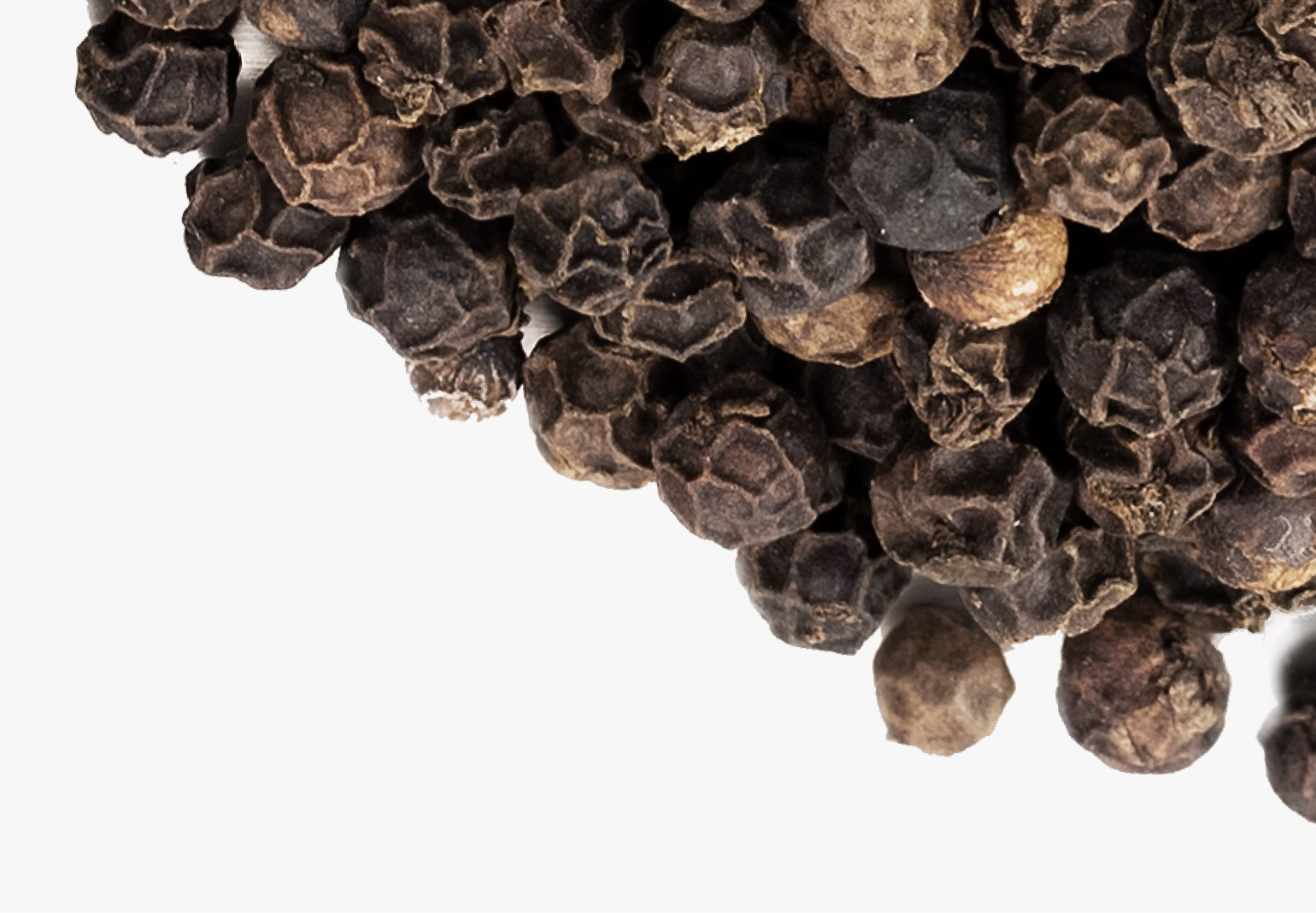 Whole black peppercorns.