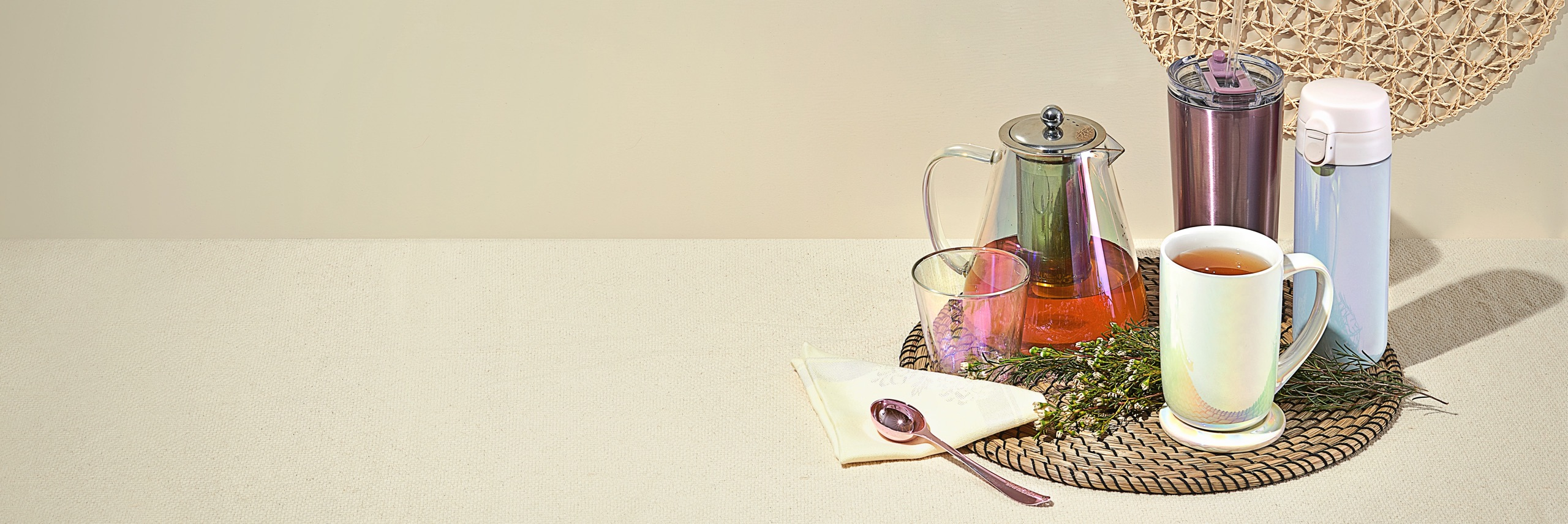 Various iridescent accessories grouped together on a weaved placemat.