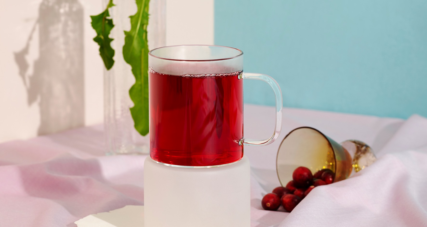 A clear mug filled with Cranberry Dandelion Detox tea.