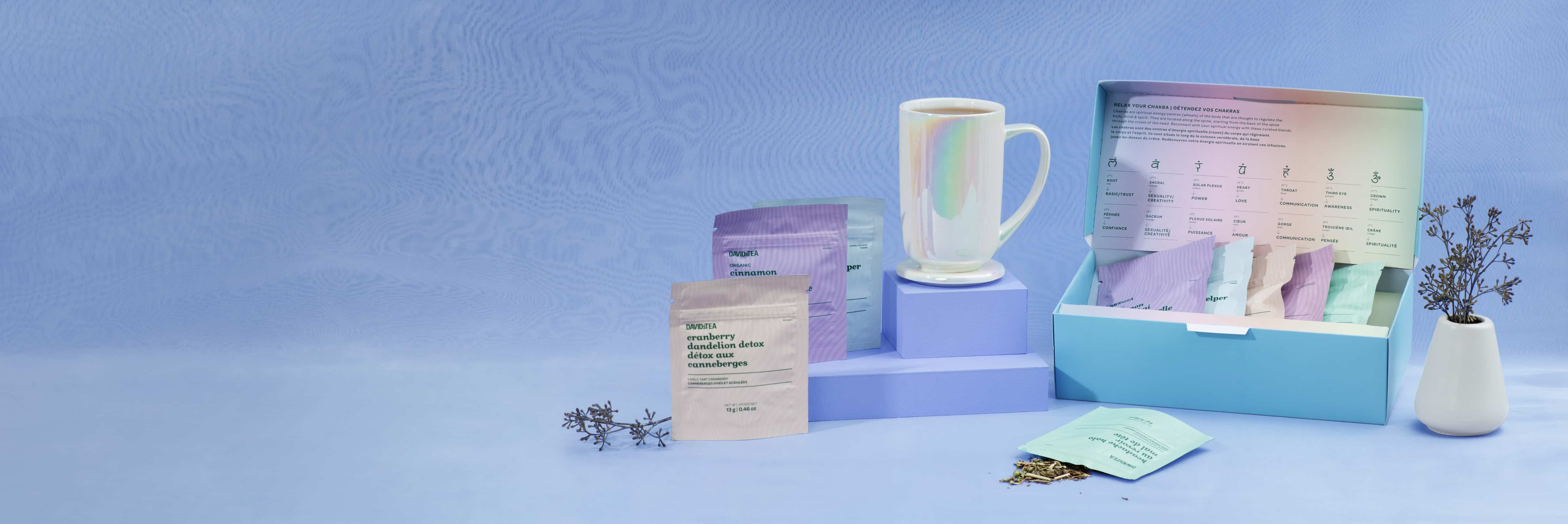 White opalescent 16 oz ceramic tea mug, open loose leaf tea kit with 5 ayurvedic teas and infusions.